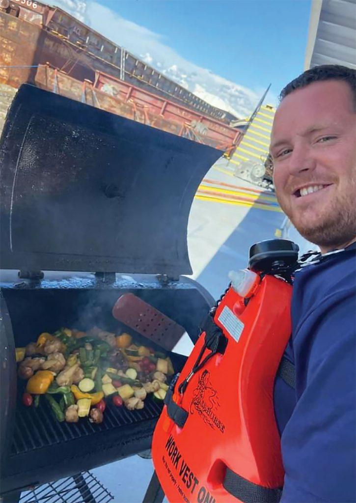 Brandon Branning grills a vegetable medley.
