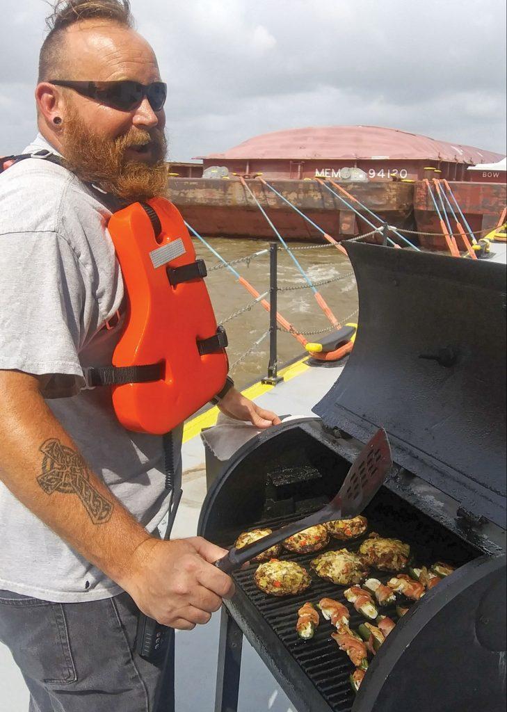 Matt Brewer grills stuffed mushrooms and jalapenos.