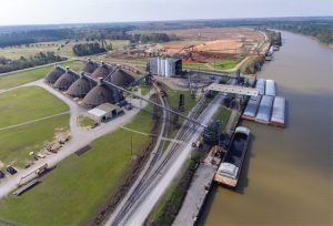 —photo courtesy of Watco Terminals At Watco's bulk terminal on the Tennessee-Tombigbee Waterway in Amory, Miss., the company can store a variety of ores and coke in its seven domes, located adjacent to the waterway.
