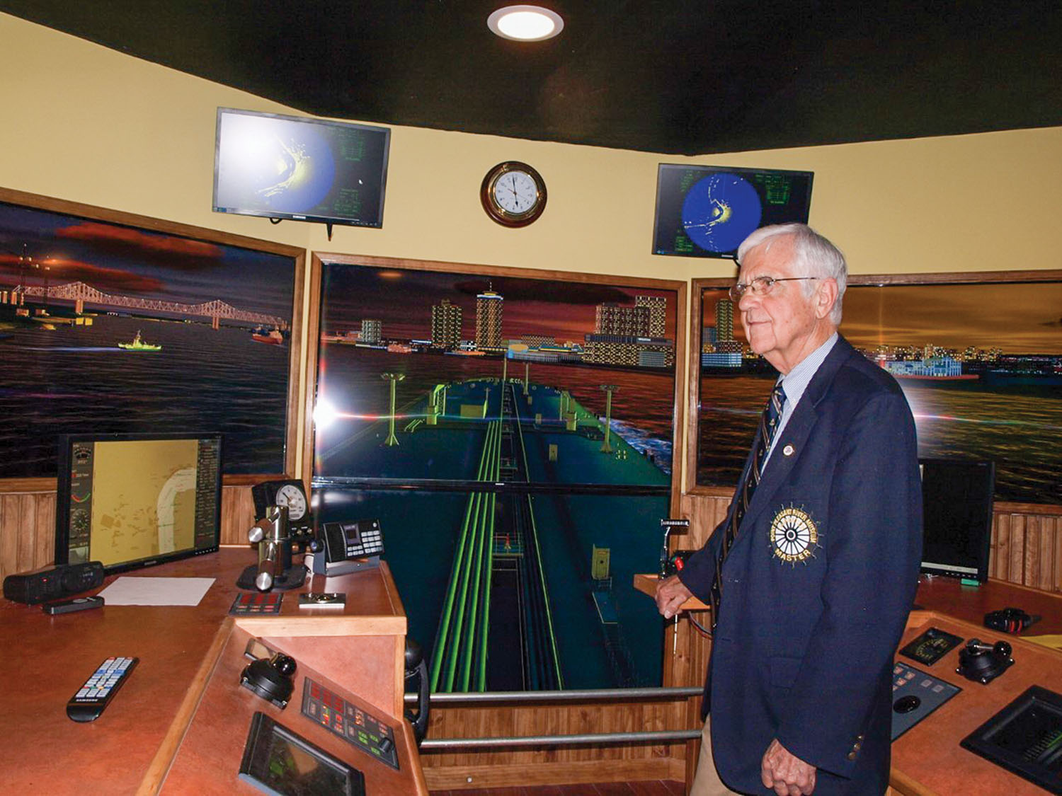 Jack Fowler at controls of simulator at Point Pleasant River Museum.