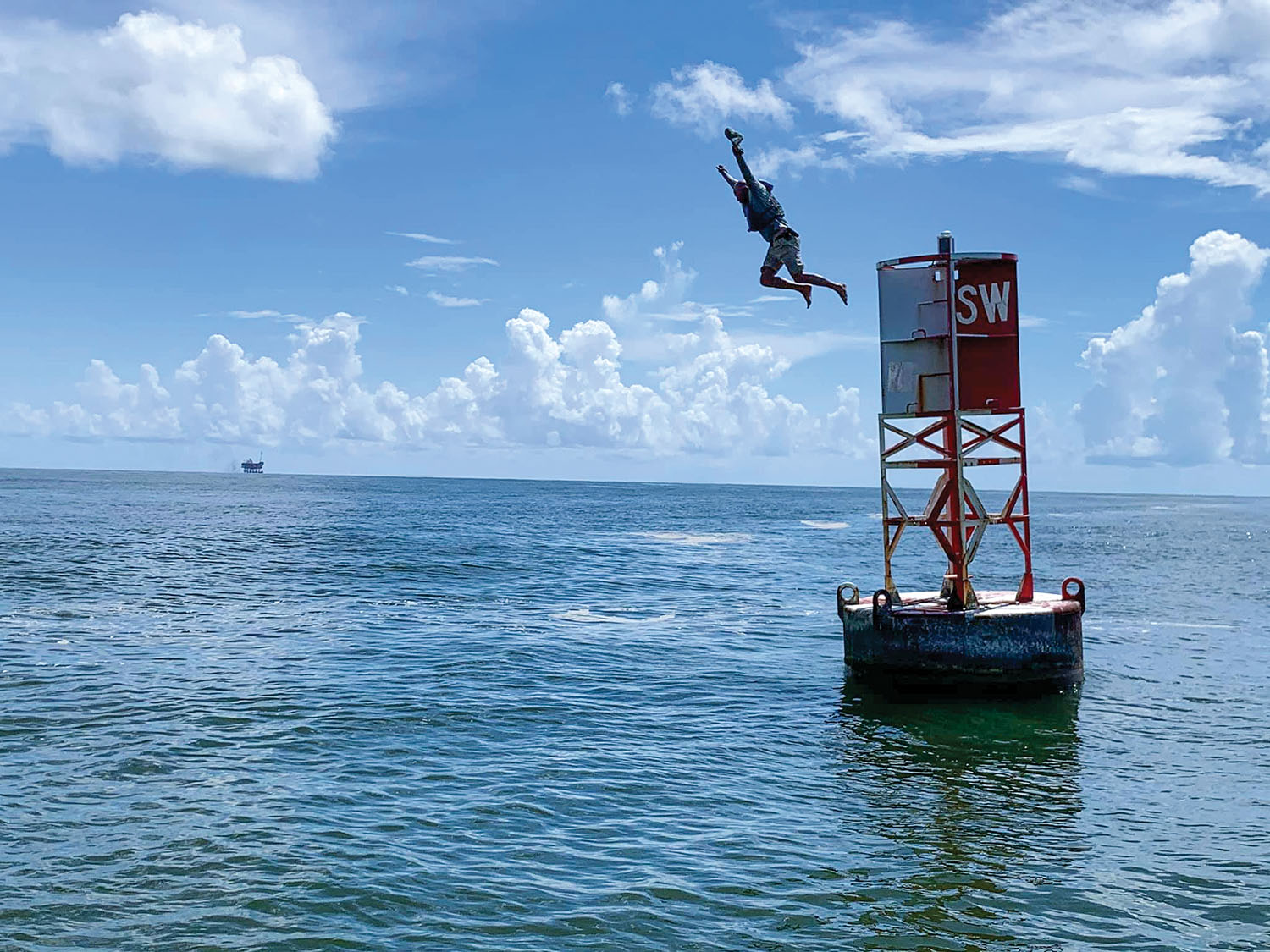Joey Cargol finished his journey with a leap from the sea buoy that marks the end of the river. (Photo courtesy of Joey Cargol)