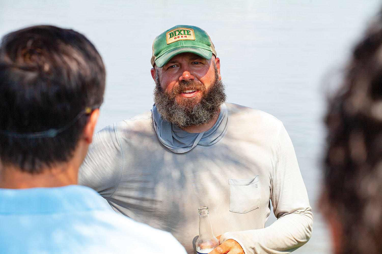 Joey Cargol recounts some of his canoeing adventures to friends and family at The Fly, a riverside park in New Orleans, August 4 on his way down the river. (Photo by Frank McCormack)