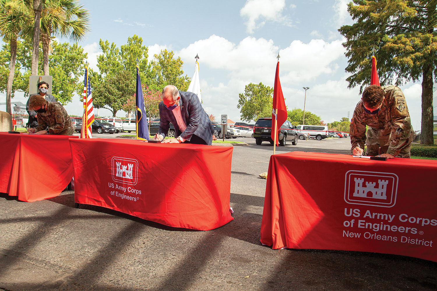 From left, Mississippi Valley Division Engineer Maj. Gen. Dianna Holland, Louisiana Gov. John Bel Edwards, and New Orleans District Engineer Col Stephen Murphy sign project partnership agreement July 31. (Photo by Frank McCormack)