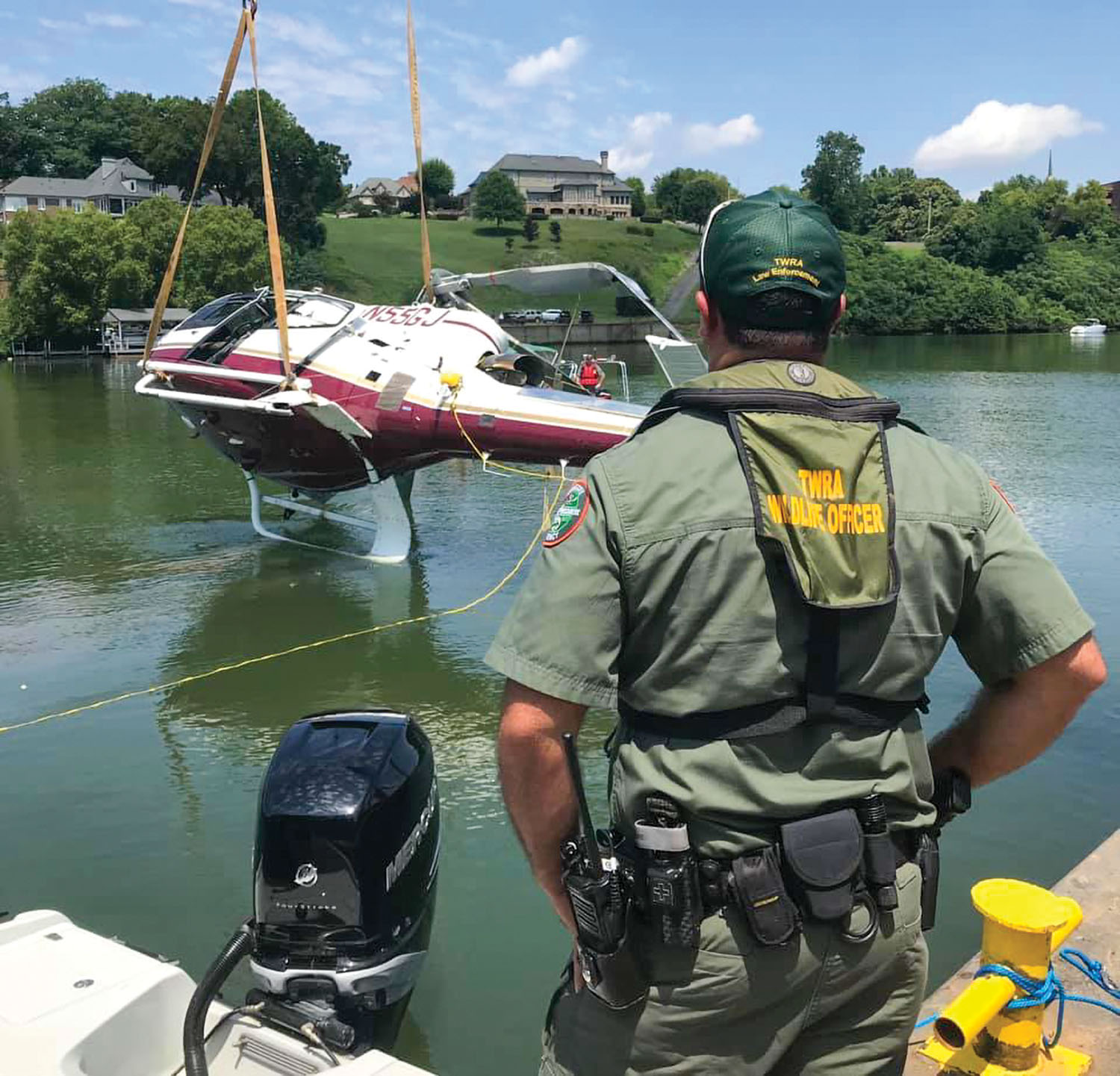 The Tennessee Wildlife Resources Agency assisted the Federal Aviation Administration in the recovery of the helicopter August 5 that crashed into Fort Loudon Lake, a reservoir of the Tennessee River. The August 3 crash killed Joe Clayton, co-founder of Clayton Automobiles and Clayton Homes. (Photo courtesy of Tennessee Wildlife Resources Agency)