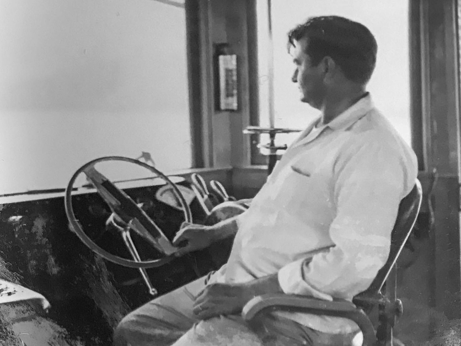 Ancel Burnett in the pilothouse of the Dan C. (Photo courtesy of Bill Burnett)