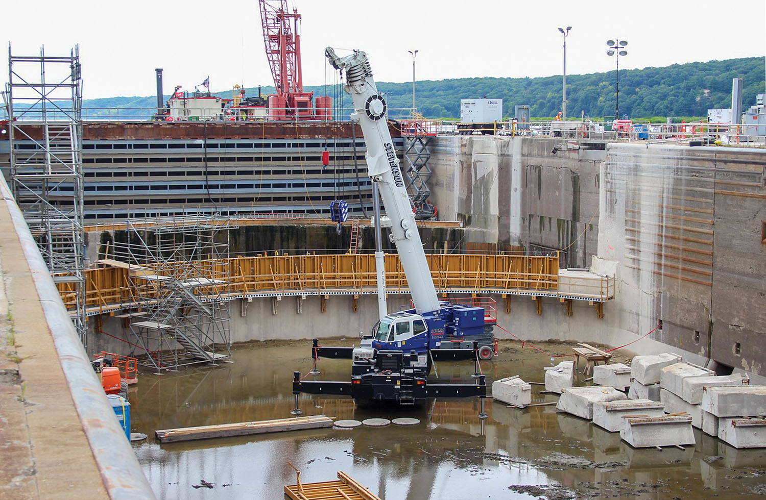 New forms being placed on the upper gate sill at Starved Rock Lock and Dam; the blocks from the old upper sill that were cut and removed are shown. (Photo courtesy of the Rock Island Engineer District)