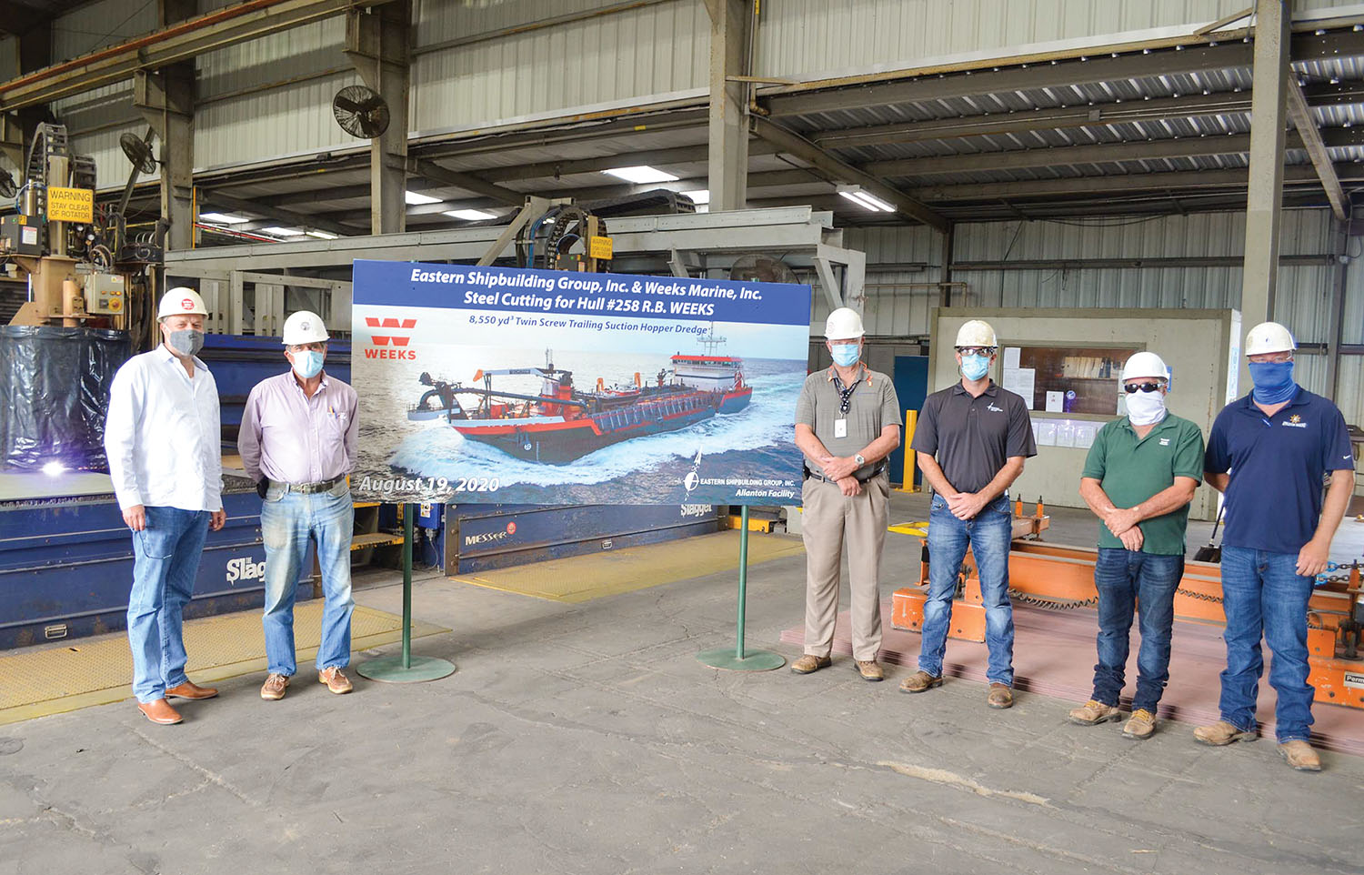 Hans Bloomberg of Weeks Marine Inc., left, stands with Eastern Shipbuilding Group representatives Brian D'Isernia, Kenneth Munroe, Jamie Keel, Benny Bramblette and Bob Babb at a ceremony celebrating the steel cutting for the R.B. Weeks.