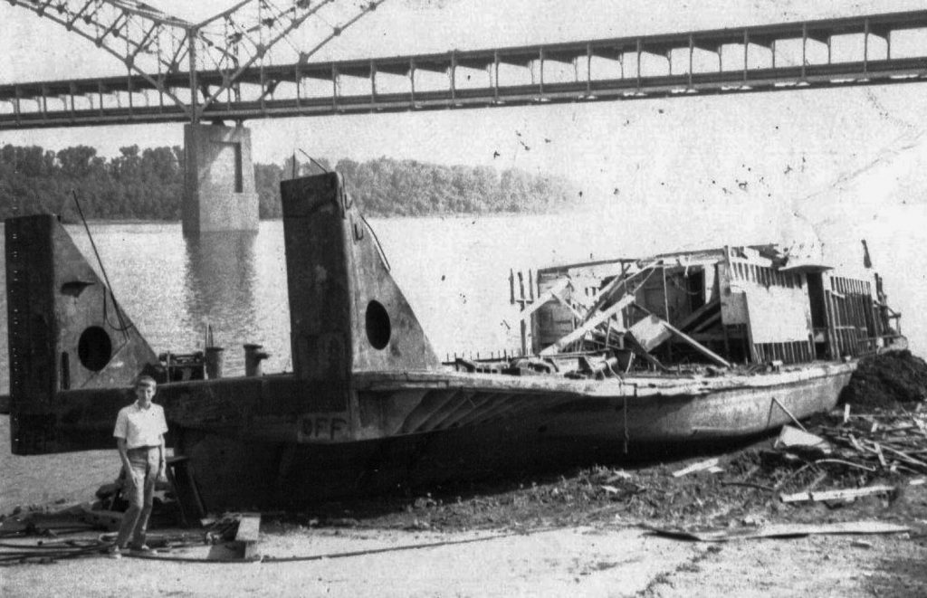 Remains of the Helen Z after the spring flood of 1970. The writer (age 16) is in the foreground. (Photo by Keith Norrington)