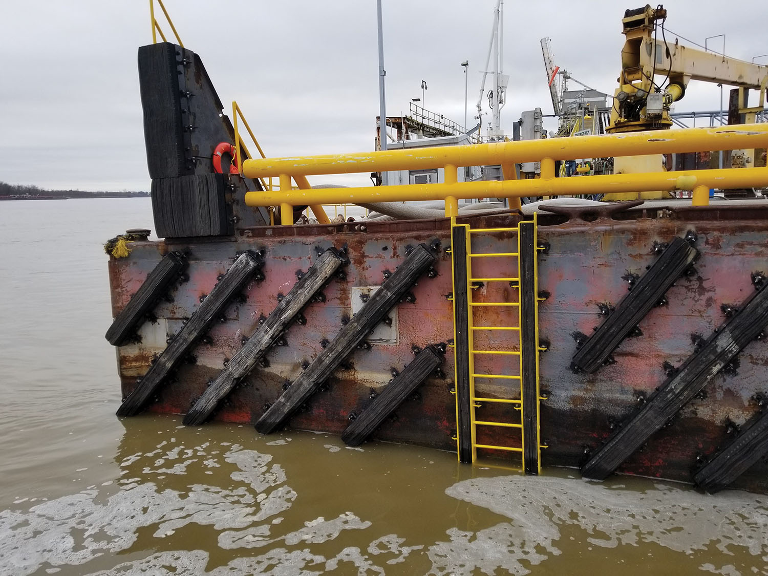 Bolt-on integrated ladder installed on barge dock. (Photo courtesy of Schuyler Maritime)