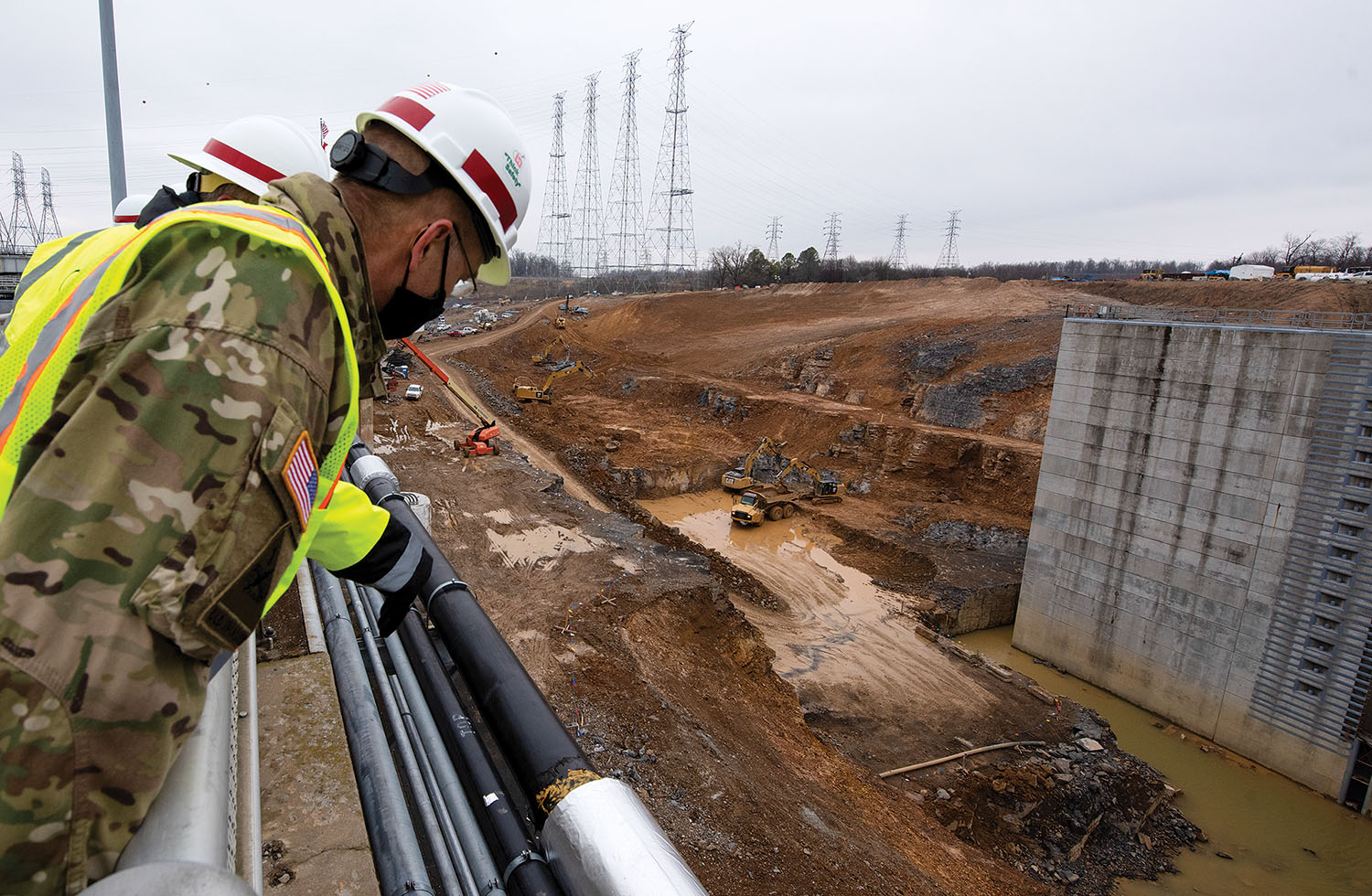 Maj. Gen. William (Butch) H. Graham, U.S. Army Corps of Engineers commanding general for civil and emergency operations, overlooks Heeter Geotechnical Construction crews excavating dirt and rock at the Kentucky Lock Addition Project December 16, 2020, where the Nashville Engineer District is constructing the new 1,200-foot navigation lock at the Tennessee Valley Authority project. (Photo by Lee Roberts/Nashville Engineer District)