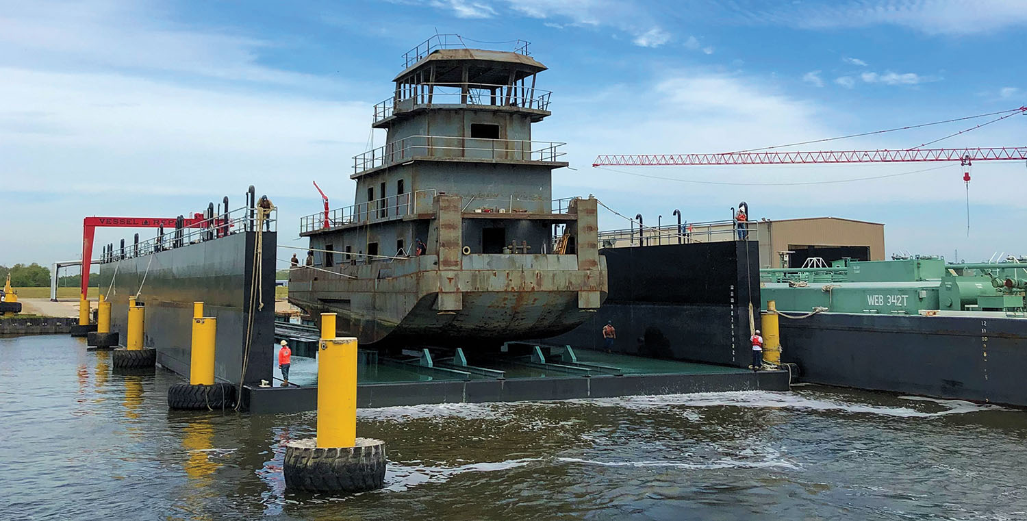 A towboat under construction at Vessel Repair is docked in the yard's new floating drydock.