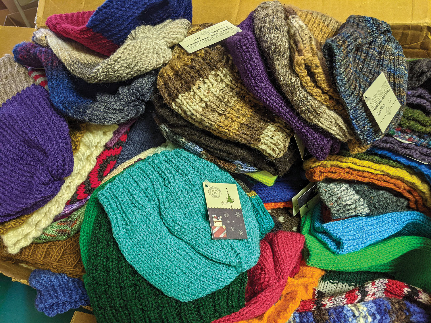 A sampling of colorful knitted hats bound for mariners this holiday season as part of Seamen's Church Institute's Christmas At Sea ministry. Photo by Frank McCormack)