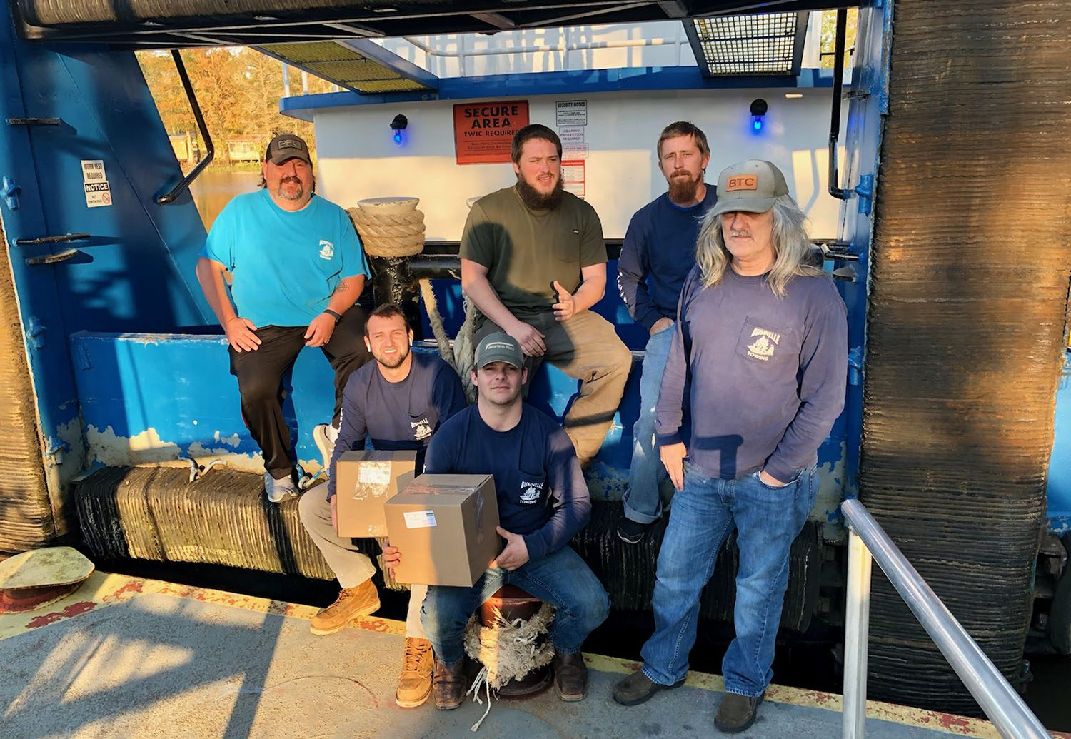 Crews of the Businelle Towing mvs. Kathleen and Theresa B, with gift boxes from the Seamen's Church Institute's Christmas at Sea Program: from left: Scott Revelle, Hunter Collins, Vernon Bolds, Ryan Vaughn, Neal Smith and Ralph Smith. (Photo courtesy of Seamen's Church Institute)