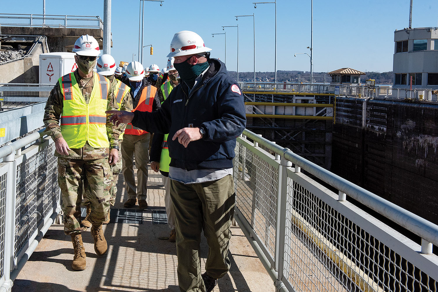 Cory Richardson, Chickamauga lockmaster, leads Lt. Gen. Scott Spellmon, 55th chief of engineers, on a tour of Chickamauga Lock on the Tennessee River on February 3. The lock has experienced structural problems and is not large enough to accommodate modern tow sizes, resulting in longer than normal tow-processing times. The Corps is building a larger replacement lock at the Tennessee Valley Authority project. (photo by Lee Roberts/Nashville Engineer District)