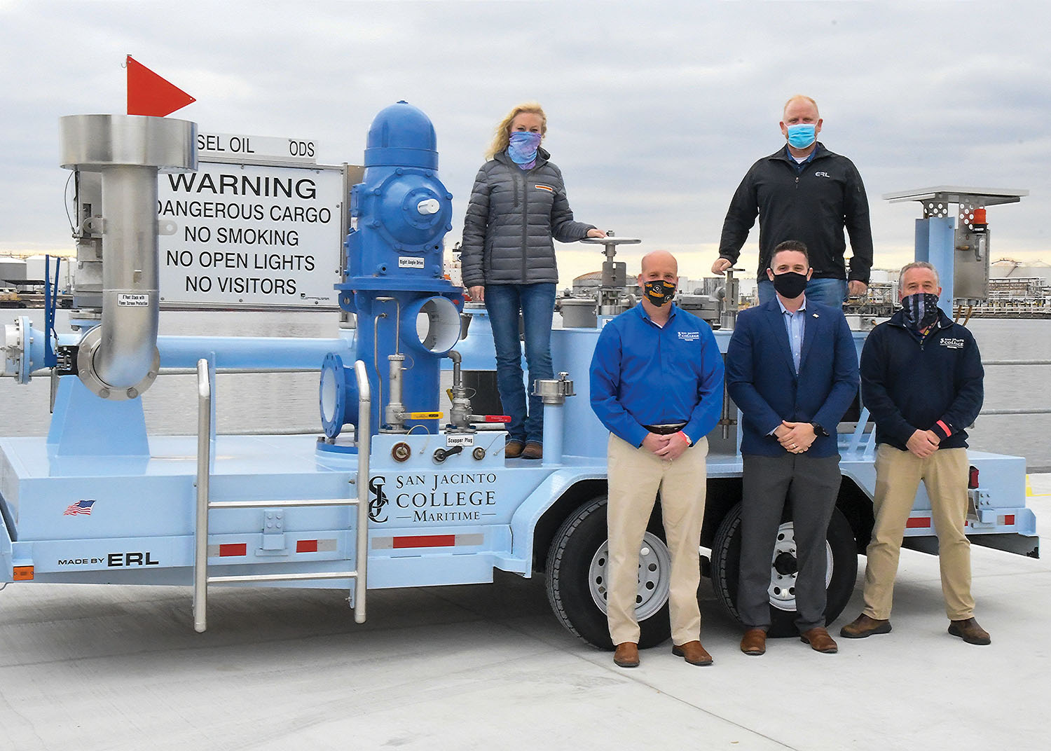 Representatives of San Jacinto College Maritime Technology & Training Center and ERL/Law Valve of Texas are pictured with the tank barge training trailer the company built for San Jac. Pictured are (top row, left to right) Amy Arrowood from San Jacinto College and Sean Ragains from ERL/Law Valve of Texas, and (front row, left to right) San Jac's John Stauffer, Craig Theiler from ERL/LVT and San Jac's Edward Horton.