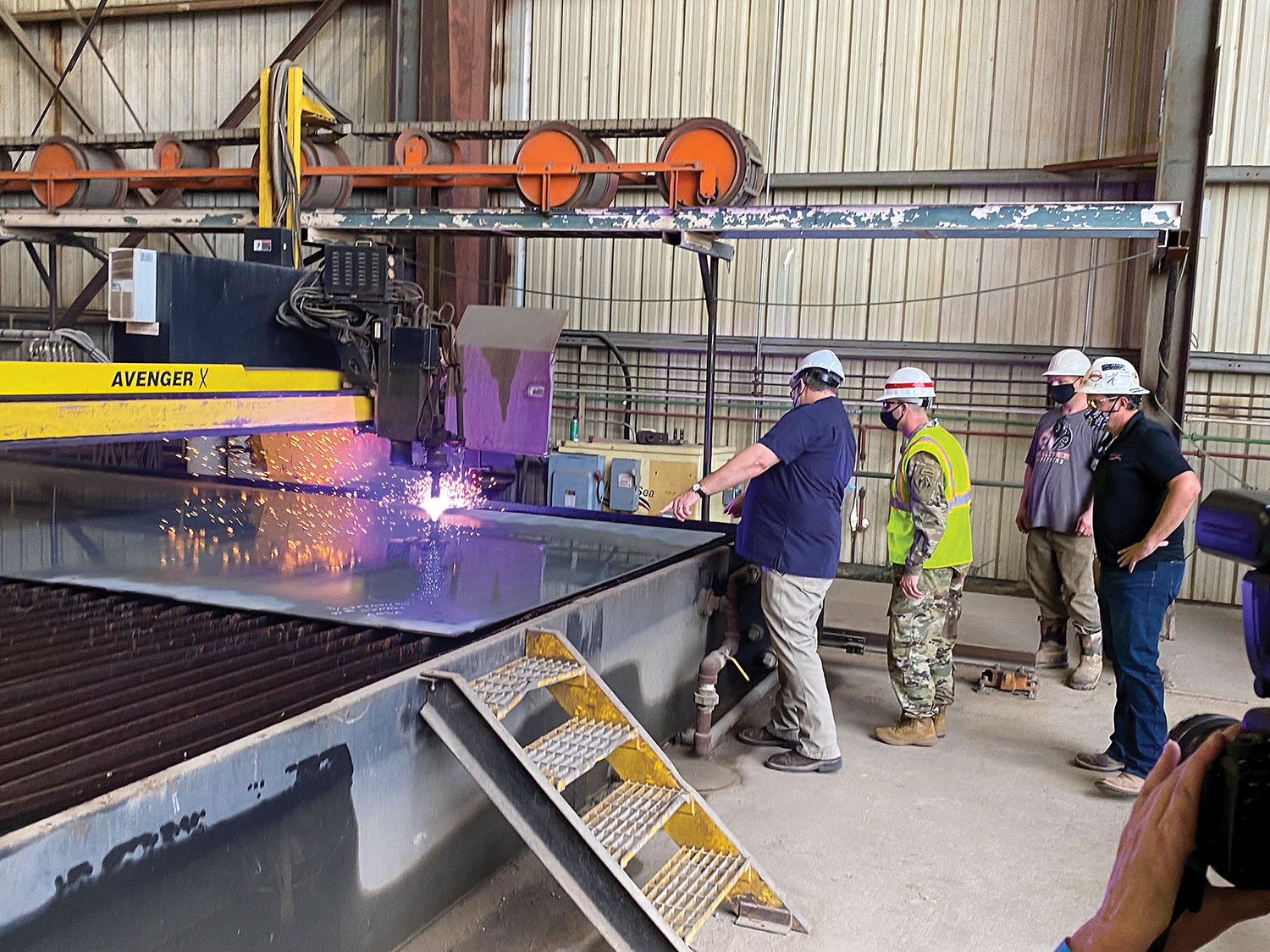 Col. Robert Hilliard, Vicksburg District commander, watches steel-cutting for ARMOR 1, the next-generation mat-sinking unit, at Thoma-Sea Shipyard.(Photo courtesy of Corps of Engineers)