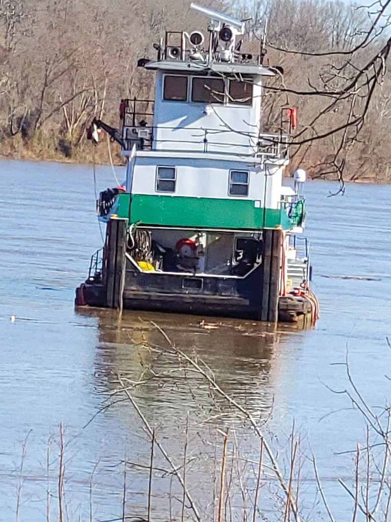 The mv. Edith Tripp free floats down the Ohio River below the Belleville Locks and Dam on March 3. The crew was able to escape in two skiffs before the boat and an empty gravel barge both went through the dam's gates. (Photo courtesy of Meigs County (Ohio) Emergency Management Director Jamie Jones)