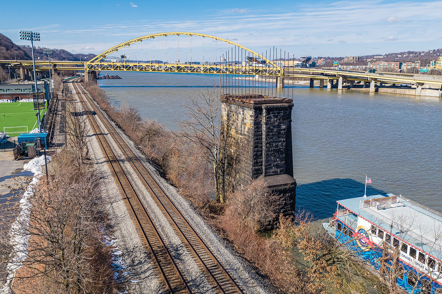 Today, all that is left of the Wabash Bridge are two 90-foot stone piers topped with flagpoles. They are sunk along both the northern and southern shores of the Monongahela River. (Photo courtesy of Hanna Langholz Wilson Ellis)