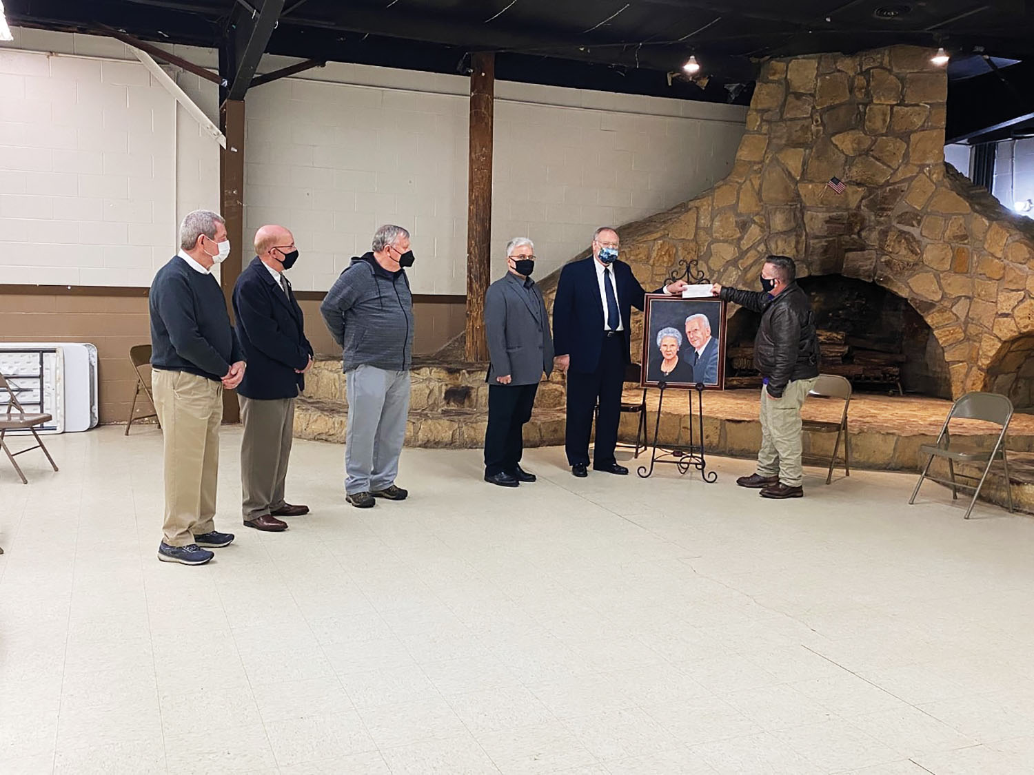 James McCormick, executive director of the Point Pleasant River Museum and Lakin Ray Clark Learning Center, receives a check from the Robert and Louis Claflin Foundation from Stephen Littlepage as Gary Field, Dennis Brumfield, Point Pleasant Mayor Brian Billings and John Sang look on. (photo courtesy of the Point Pleasant River Museum and Lakin Ray Clark Learning Center)