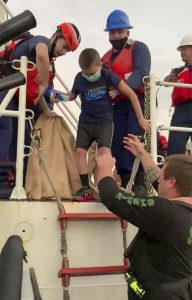 One of the family members transfers from the Coast Guard Cutter Sea Dragon to the sheriff's office vessel, prior to heading back ashore.  (Photo courtesy of Nassau County Sheriff's Office)