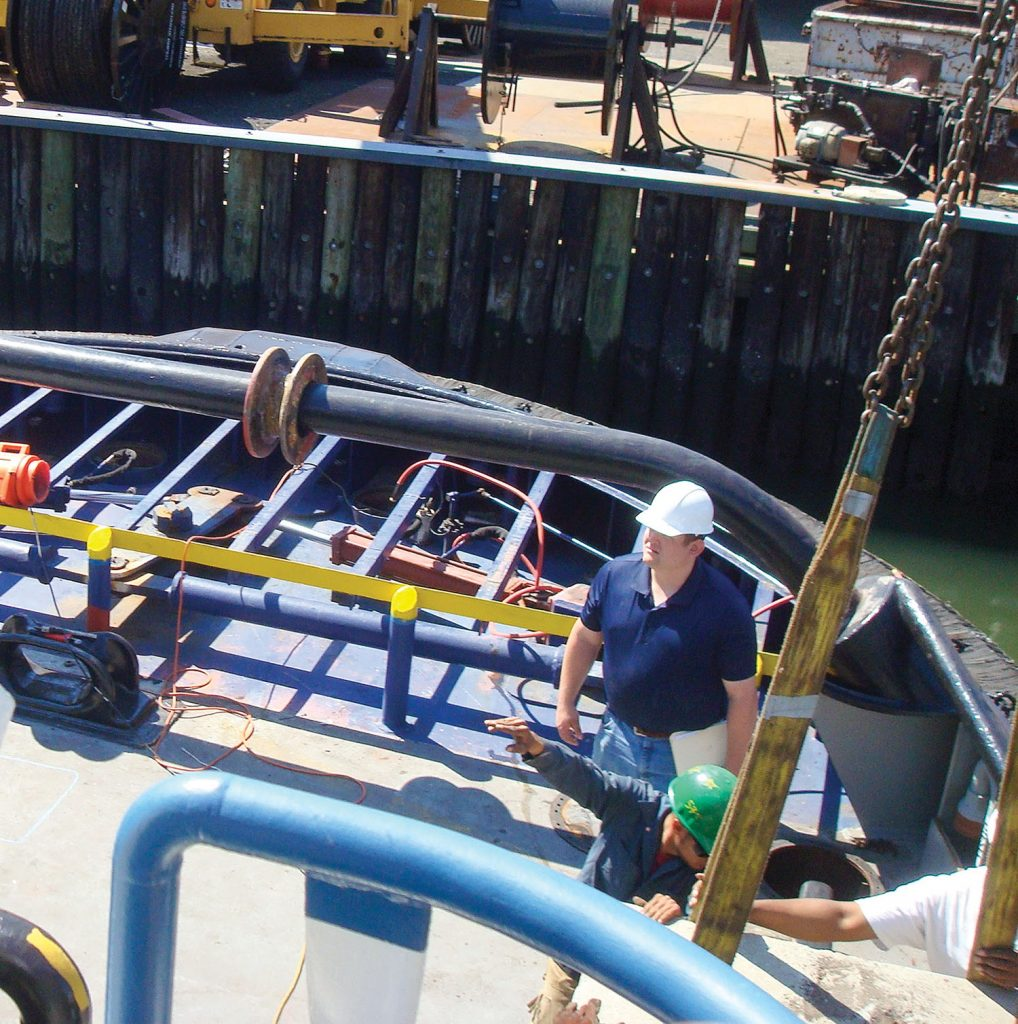 —photos courtesy JMS Naval Architects A naval architect from JMS Naval Architects works out in the field. JMS engineers bring their deck plate experience to all engineering and design projects.