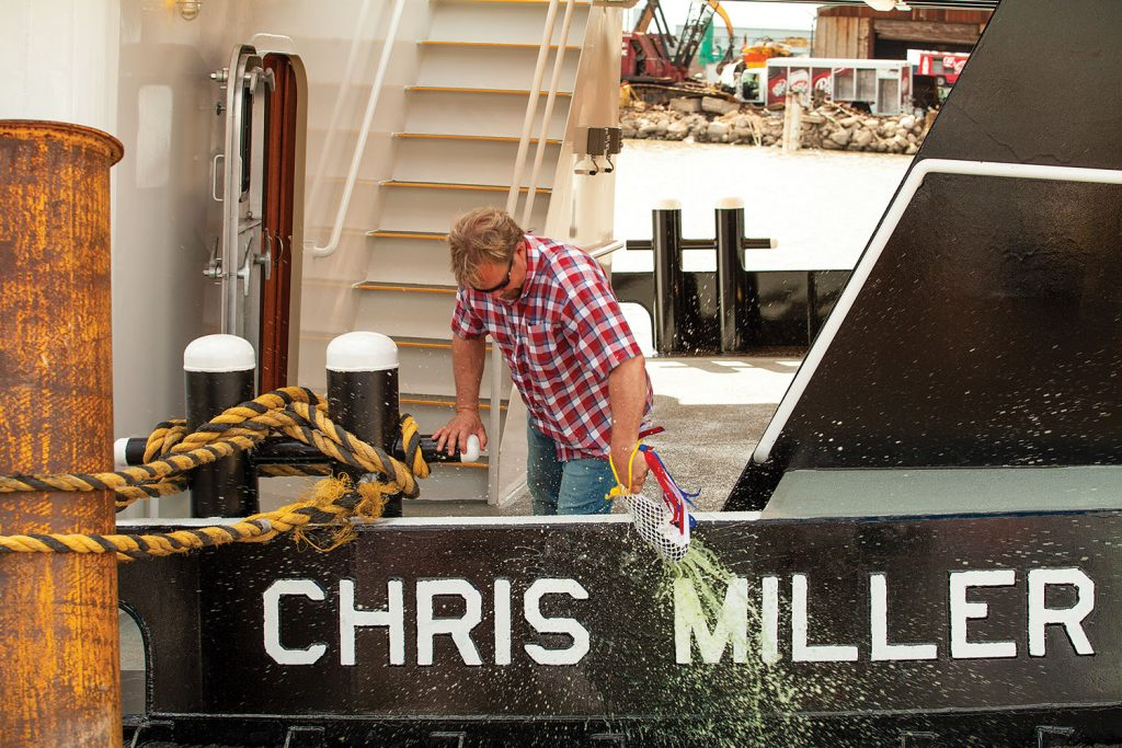 Chris Miller christens his namesake towboat. (photo by Frank McCormack)