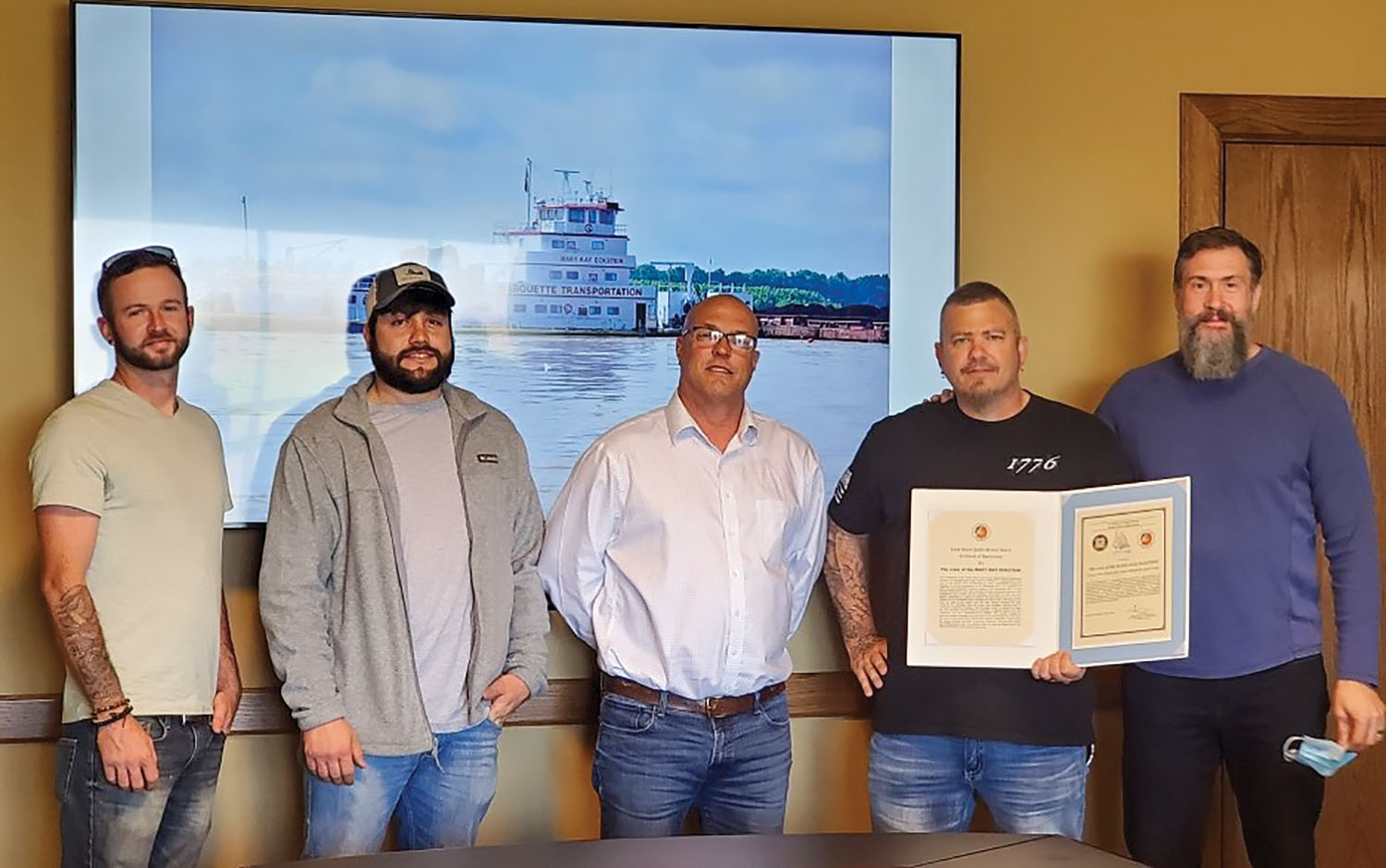 The Coast Guard has honored the crew of the mv. Mary Kay Eckstein with a public service award certificate of appreciation in connection with three separate rescues. Pictured (left to right) are Thomas Cottrell, mate; Colby Mitchell, senior mate; Gary Frayser, senior port captain; David Helton, high captain; and Chris Myskowski, Marquette Transportation's senior vice president of operations, river division. (Photo courtesy of Marquette Transportation)