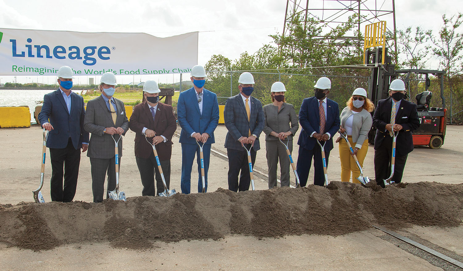 Officials—including Louisiana Gov. John Bel Edwards and Port NOLA President and CEO Brandy Christian, center—break ground April 6 for the $42 million expansion project. (Photo by Frank McCormack)
