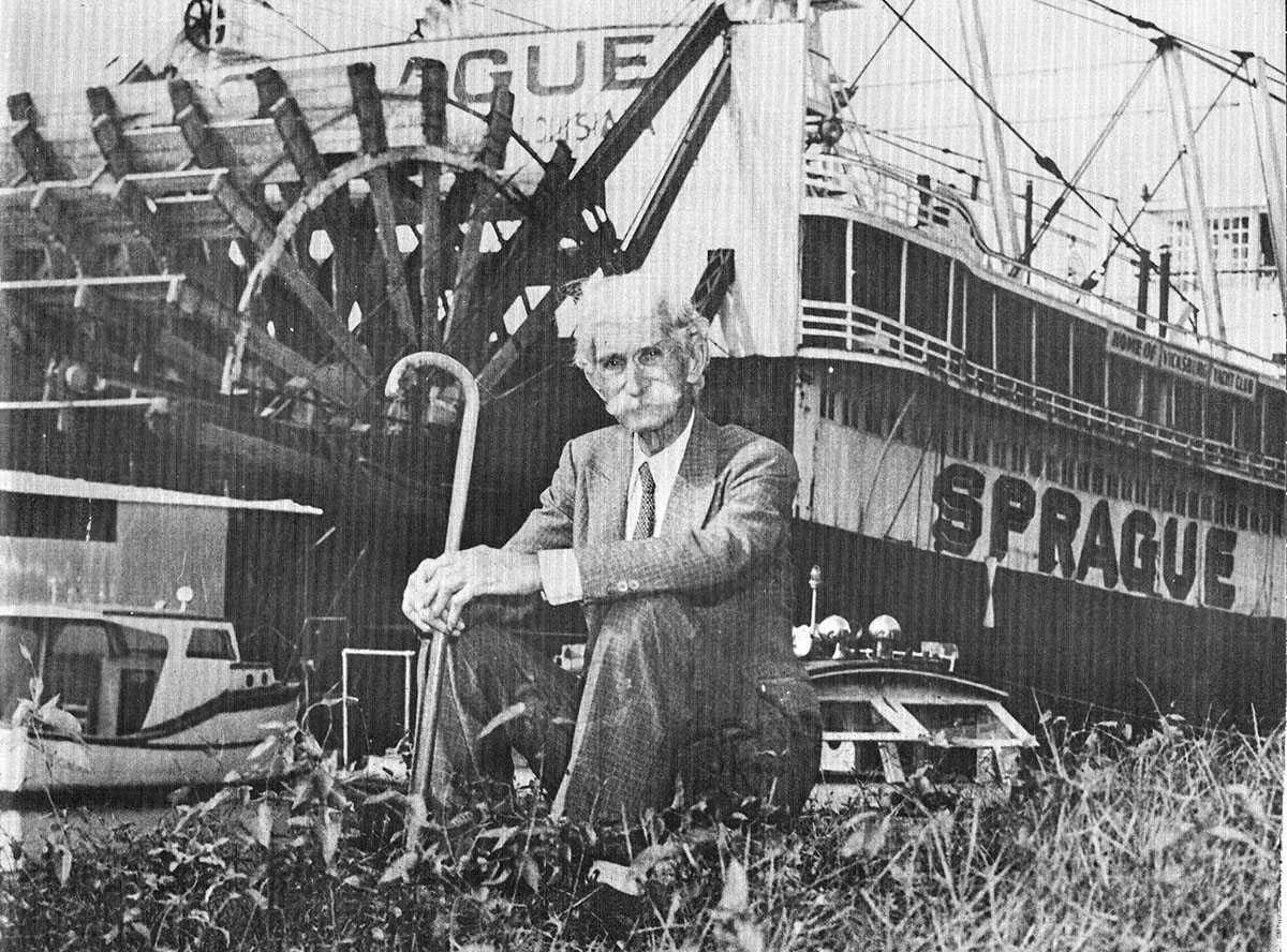 Photographer J. Mack Moore poses with the Str. Sprague on the Vicksburg waterfront in 1948. (Keith Norrington collection)