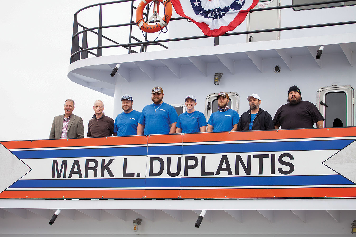 The crew members of the mv. Mark L. Duplantis, from left to right, are Capt. Nathan Basnett; James Johnson, pilot; lead deckhand Stephen Morgan; deckhands Devon Gauthreaux and Melissa Schneller; Jarod Gordon, mate; Jeremy Mayes, cook; and Chief Engineer Robert Ahdosy. (Photo by Frank McCormack)