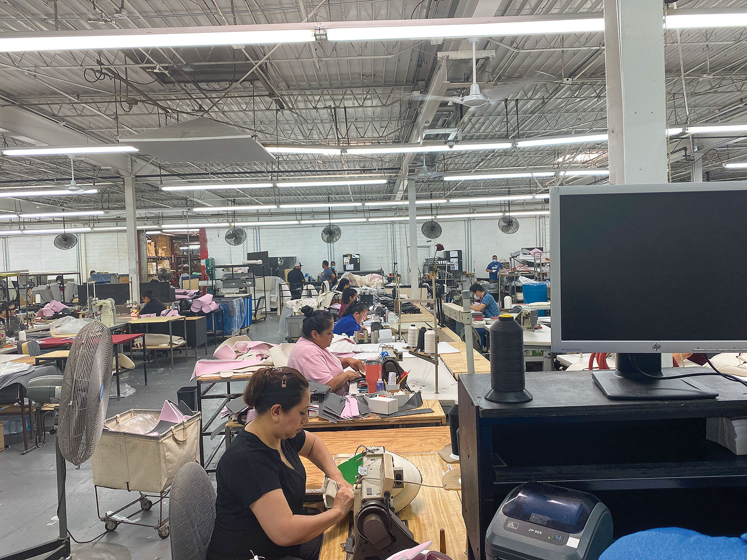 A line of sewing operators sews covers at Llebroc Industries. (Photo courtesy of Llebroc Industries)