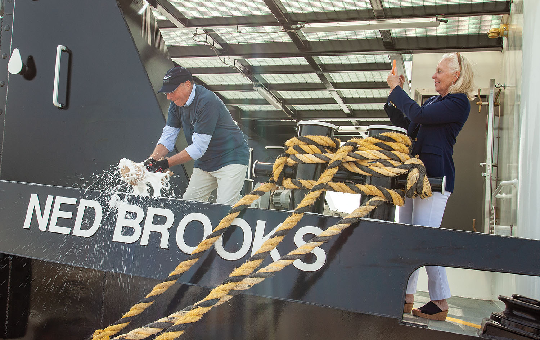 Ned Brooks christens his namesake vessel. (Photo by Frank McCormack)