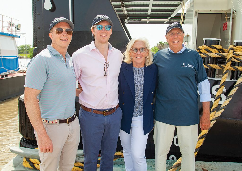 Members of the Brooks family, including (from left) Avery, Bick, Louise and Ned, stand beside the mv. Ned Brooks. (Photo by Frank McCormack)