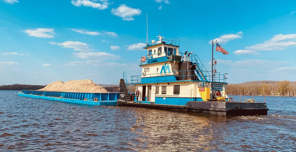 The Scarlette River, another of the repowered boats, works on a Corps of Engineers Habitat Rehabilitation and Enhancement Project (HREP). (Photo courtesy of Newt Marine Service)