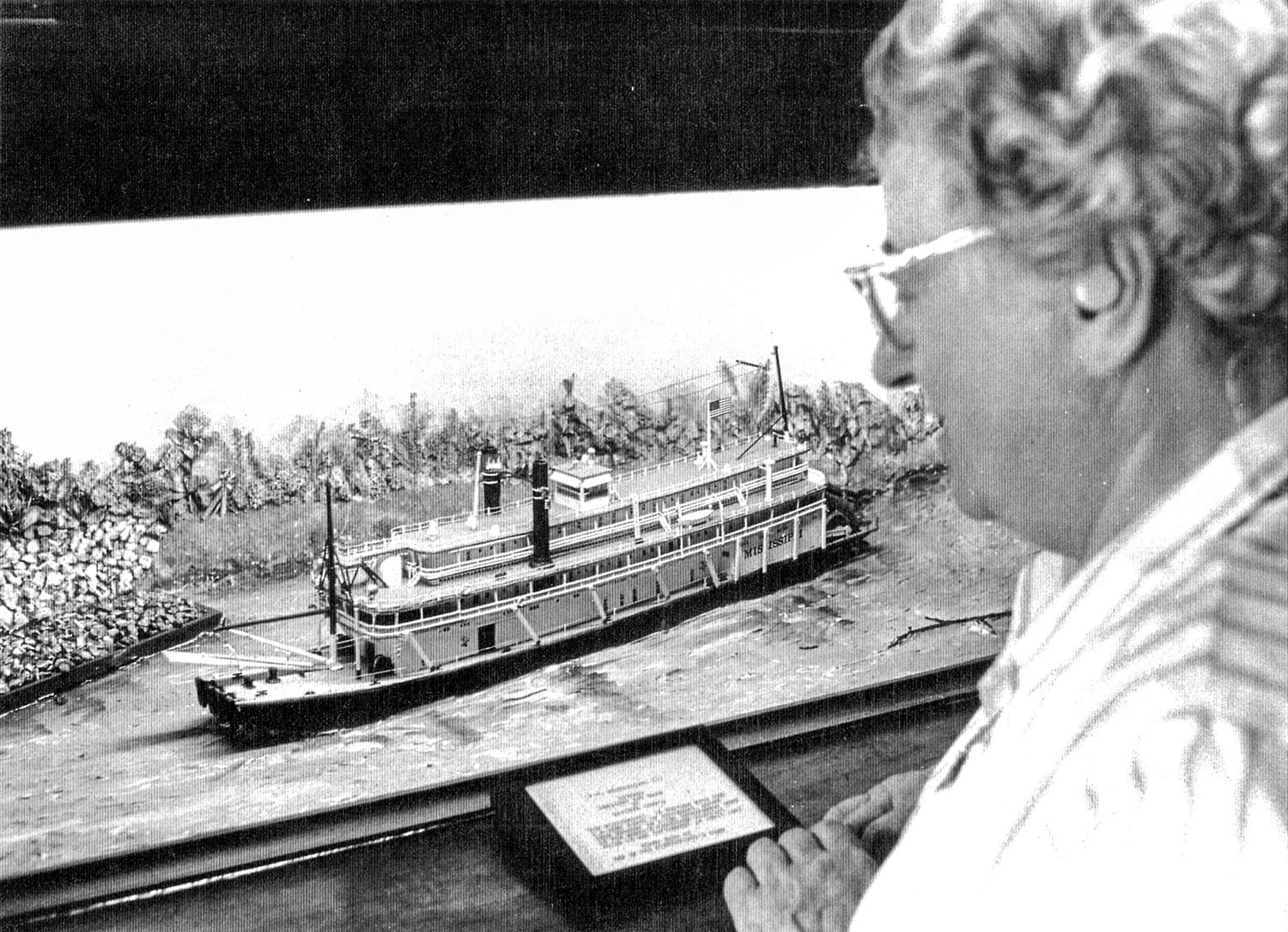 Midship Museum curator Ruth Ferris looks at a model (built by a crew member) of the Str. Mississippi III. (Keith Norrington collection)