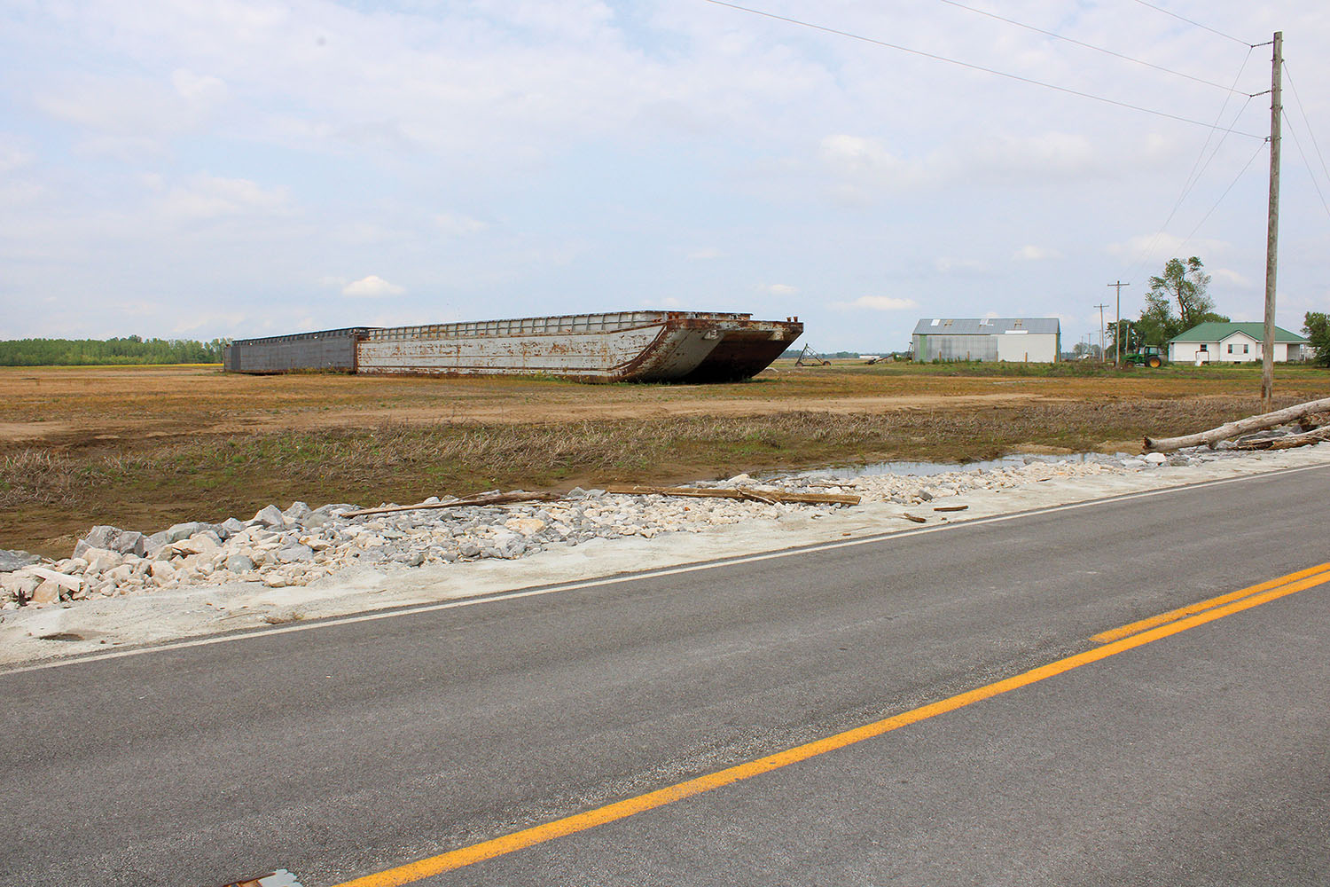 These two barges remain stranded in a southern Illinois farmer's field nearly two years after they were sucked through a hole in the Len Small Levee during high-water event on the Mississippi River. (Photo by Shelley Byrne)