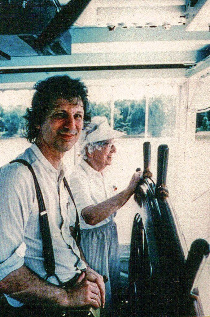 Capt. John Hartford and Ruth Ferris at the wheel of the Julia Belle Swain. (Photo by Dan Martin)