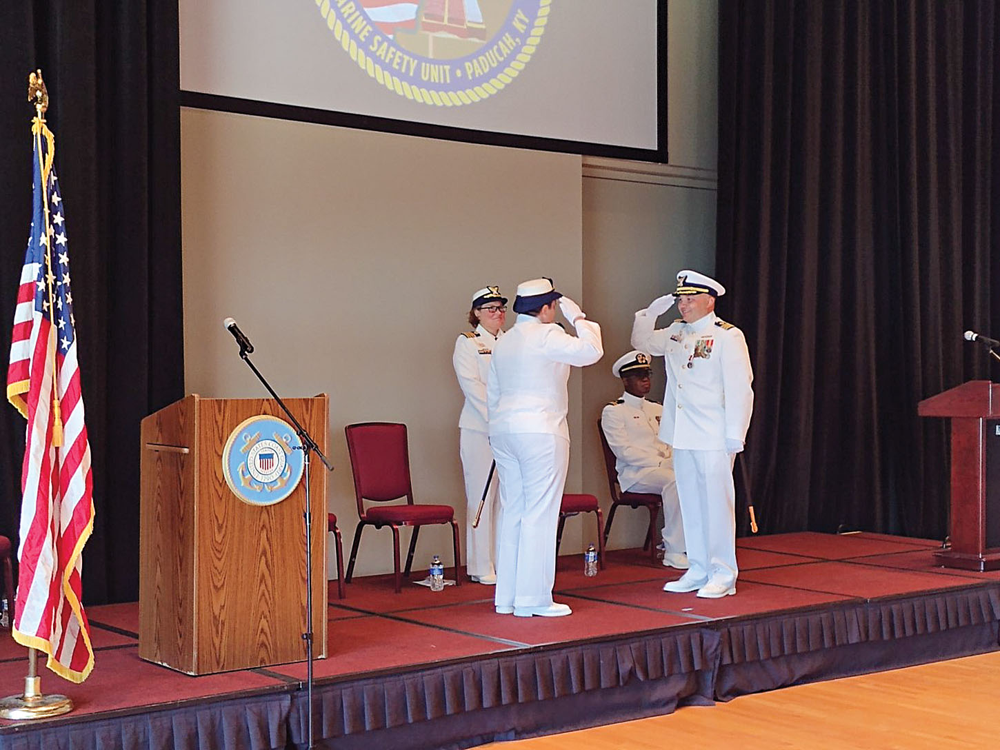 Caption for photo: Cmdr. Jennifer G. Andrew and Cmdr. Luis Carmona salute during a June 4 change of command ceremony. The ceremony featured remarks from both, along with awards and a few surprises. (Photo by Shelley Byrne)