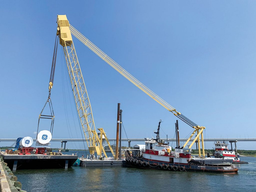 The heavy lift derrick Ocean Ranger loads General Electric turbines in Charleston. They were delivered from Charleston to East China, Mich., via the St. Lawrence Seaway. (Photo courtesy of Stevens Towing)