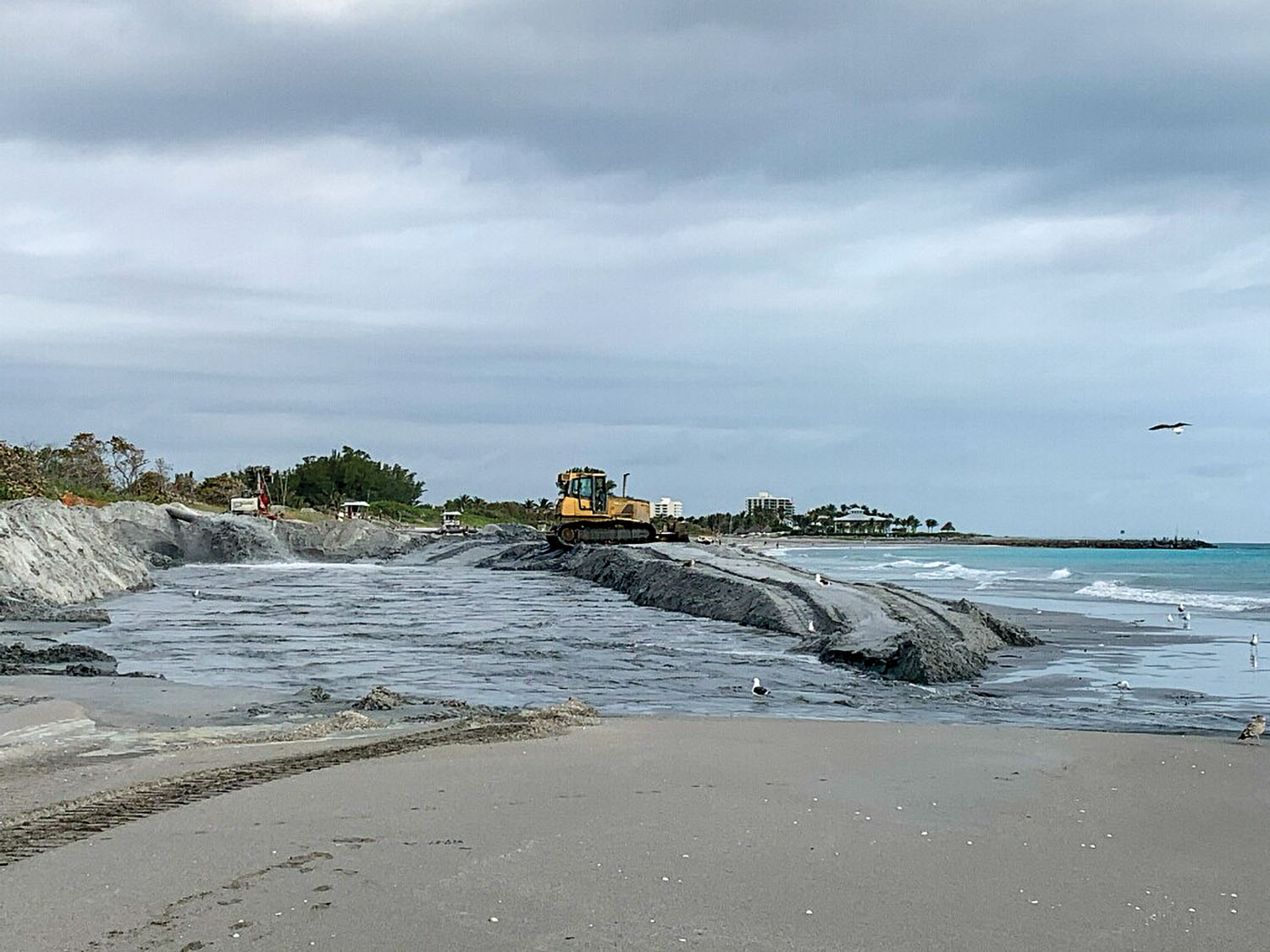 A beneficial use project allows dredged sand to be placed on a beach in the Jupiter, Fla., area.