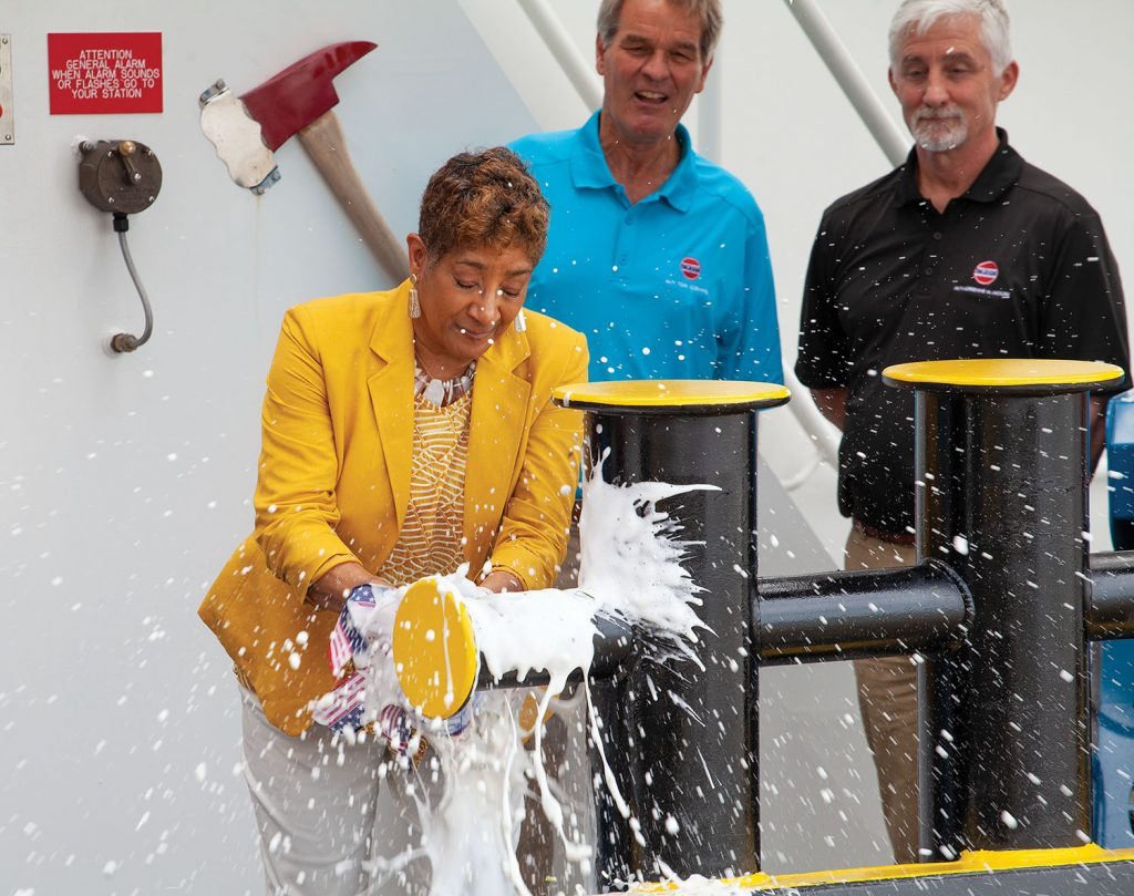Adrienne Moore christens towboat named in her honor while Orrin Ingram and Dave O'Loughlin look on. (Photo by Frank McCormack)