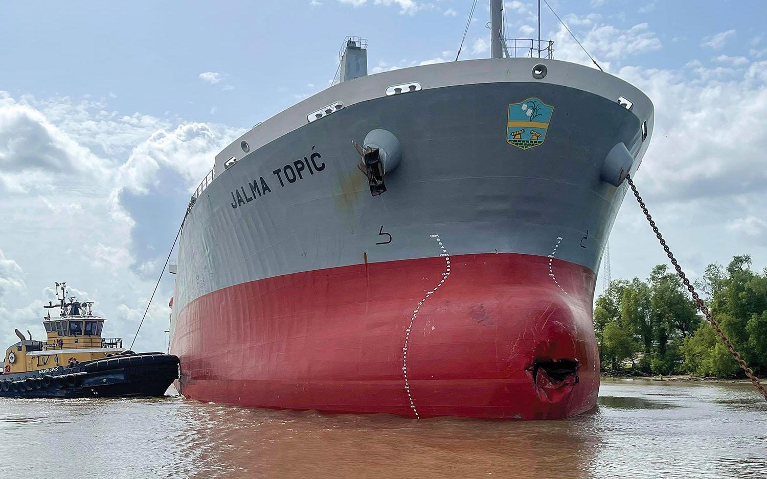 Ship Loses Steerage, Allides With Crescent Towing Office Barge
