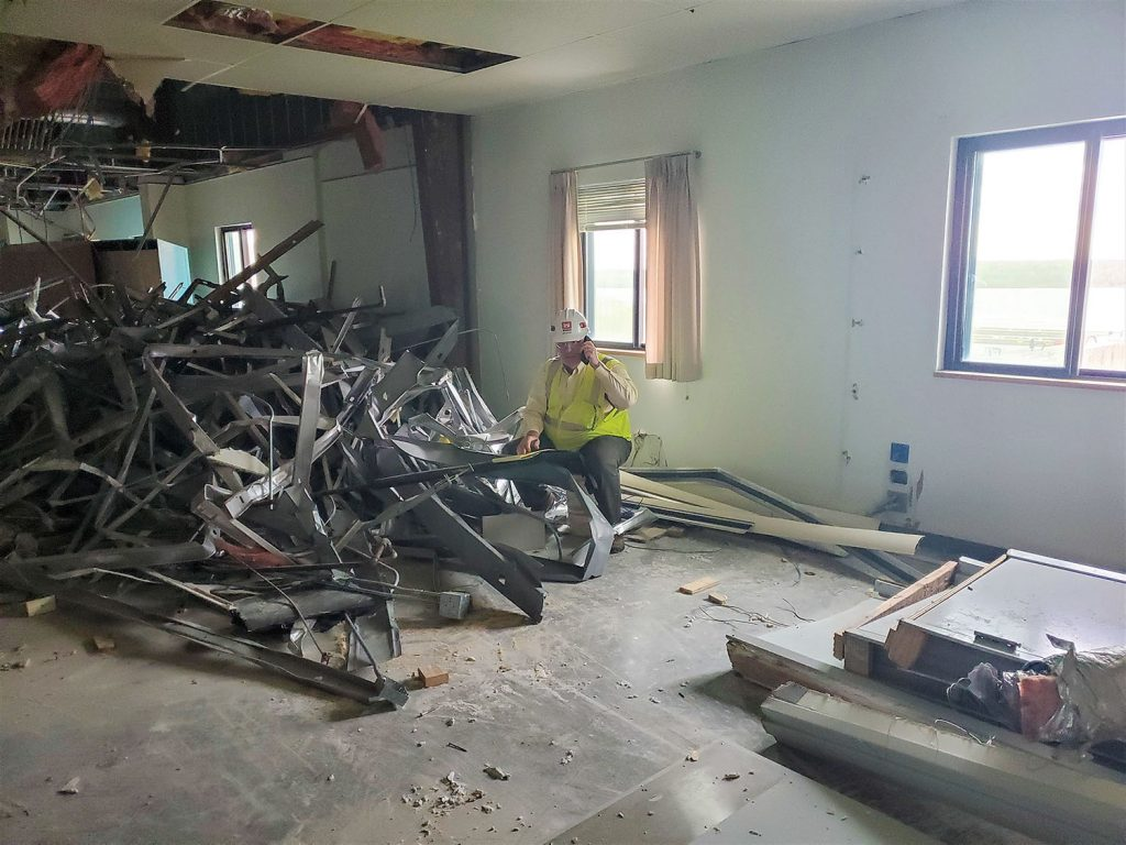 Bill Hunter sits in the Olmsted Resident Office, which is being demolished after more than 30 years of use at the construction site for Olmsted Locks and Dam. (Photo courtesy Louisville Engineer District)