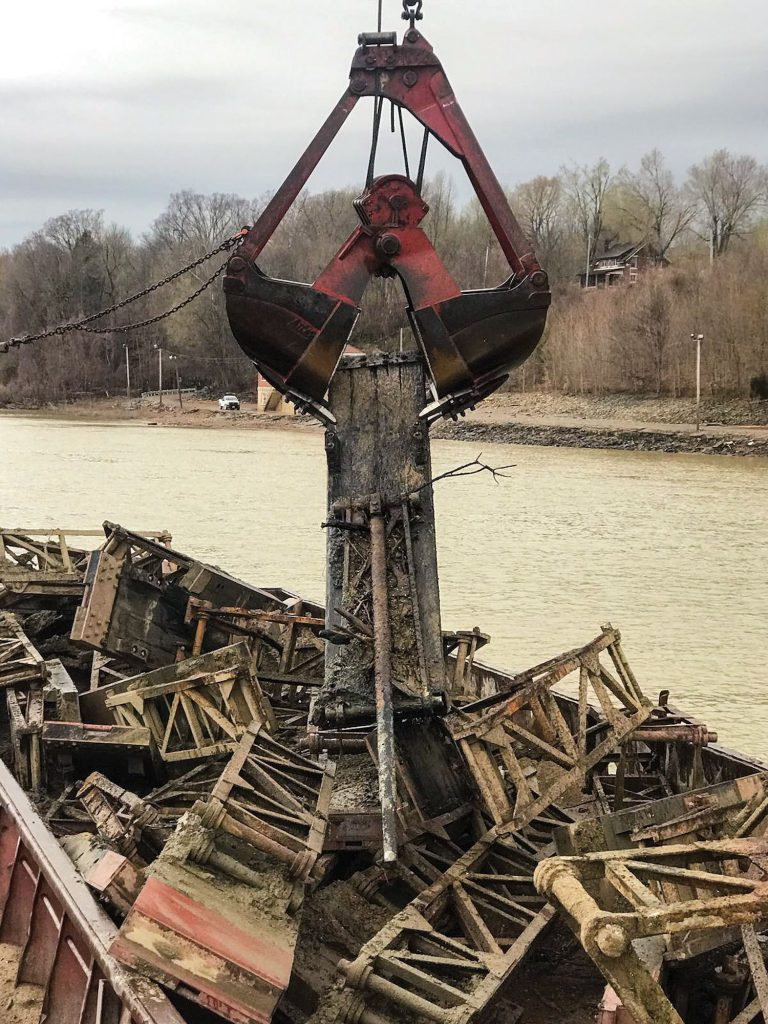 Wickets are removed from the former Dam 53 during early demolition stages in December 2019. (Photo courtesy Louisville Engineer District)