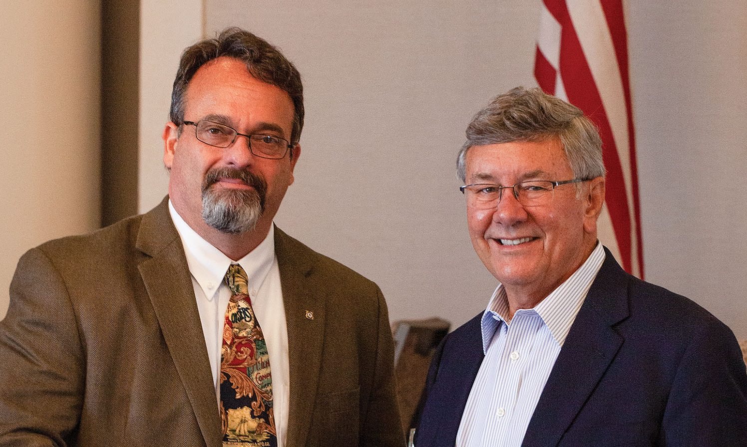 Paul Dittman, left, and Jim Stark, both former Coast Guard captains, are the incoming and outgoing, respectively, presidents of the Gulf Intracoastal Canal Association. (Photo by Frank McCormack)