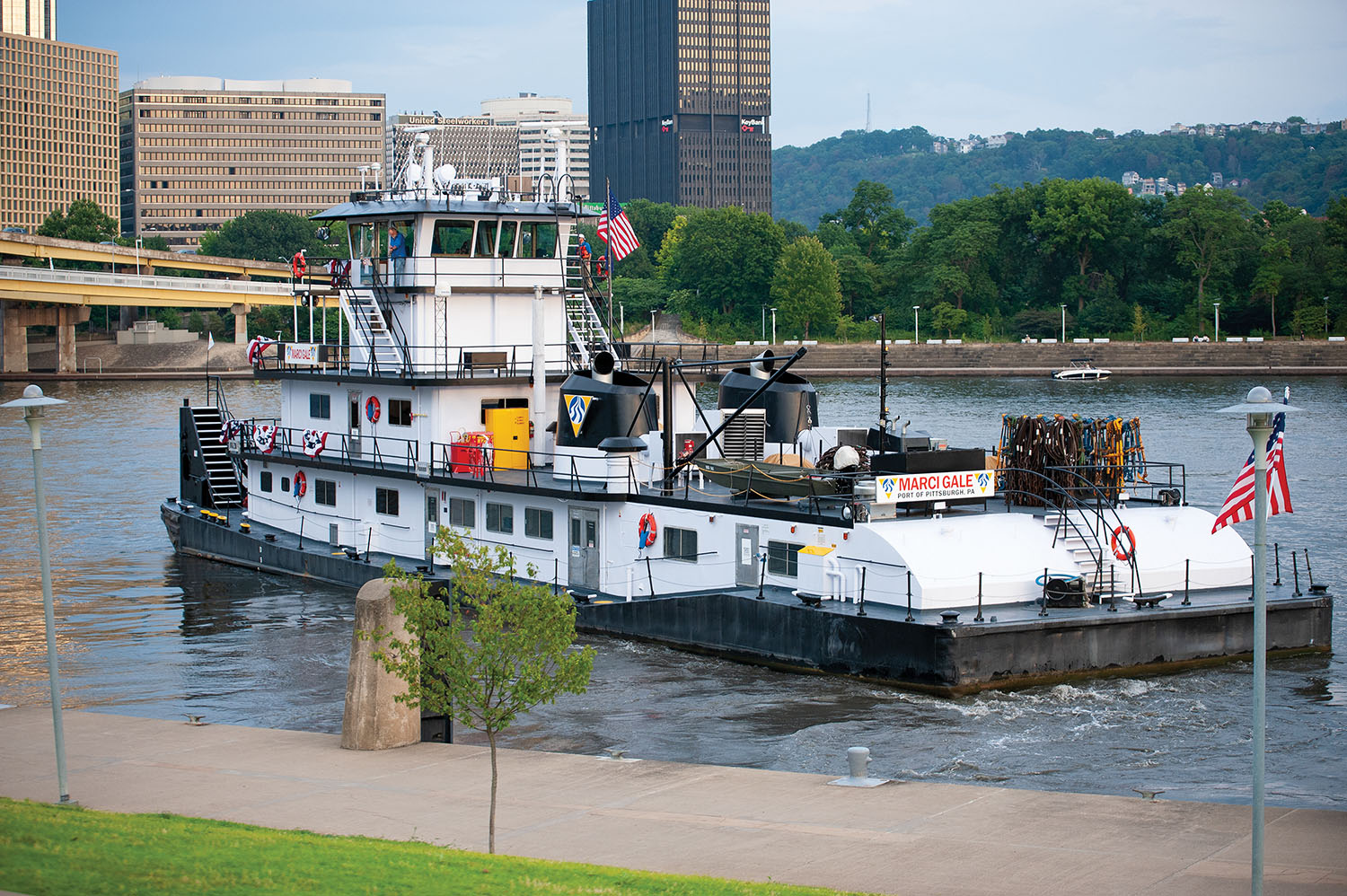 The mv. Marci Gale leaves the christening ceremony to go to work. The 4,300 hp. towboat is the former Elizabeth Lane, which Campbell bought from Canal Barge Company and had extensively refurbished at Main Iron Works. (Photo by Fisher Fotos)