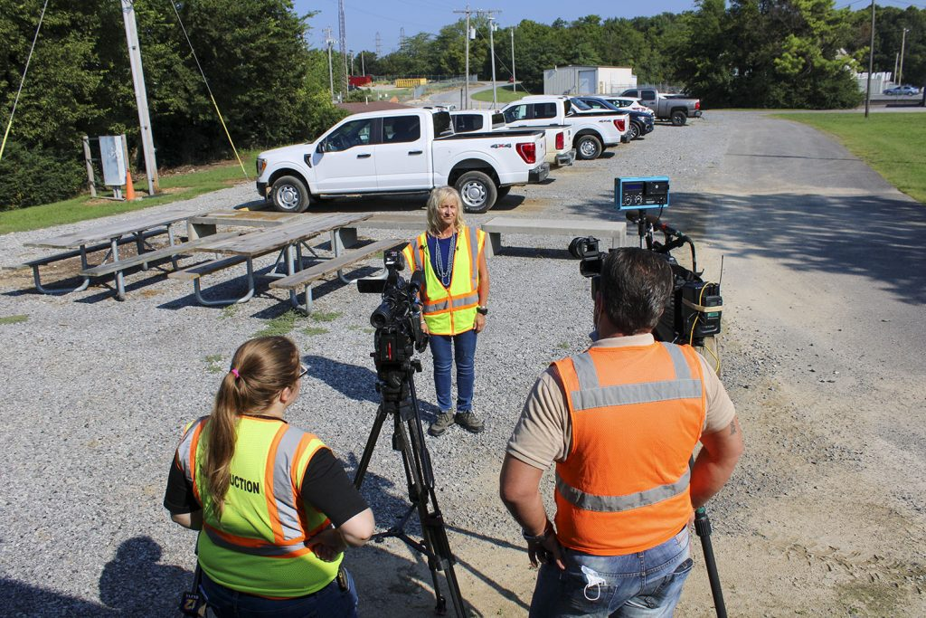 Deb Calhoun, Waterways Council Inc. senior vice president, gives an interview to CBS and NBC affiliate television stations outside the resident office for the Kentucky Lock Addition Project. (photo by Shelley Byrne)