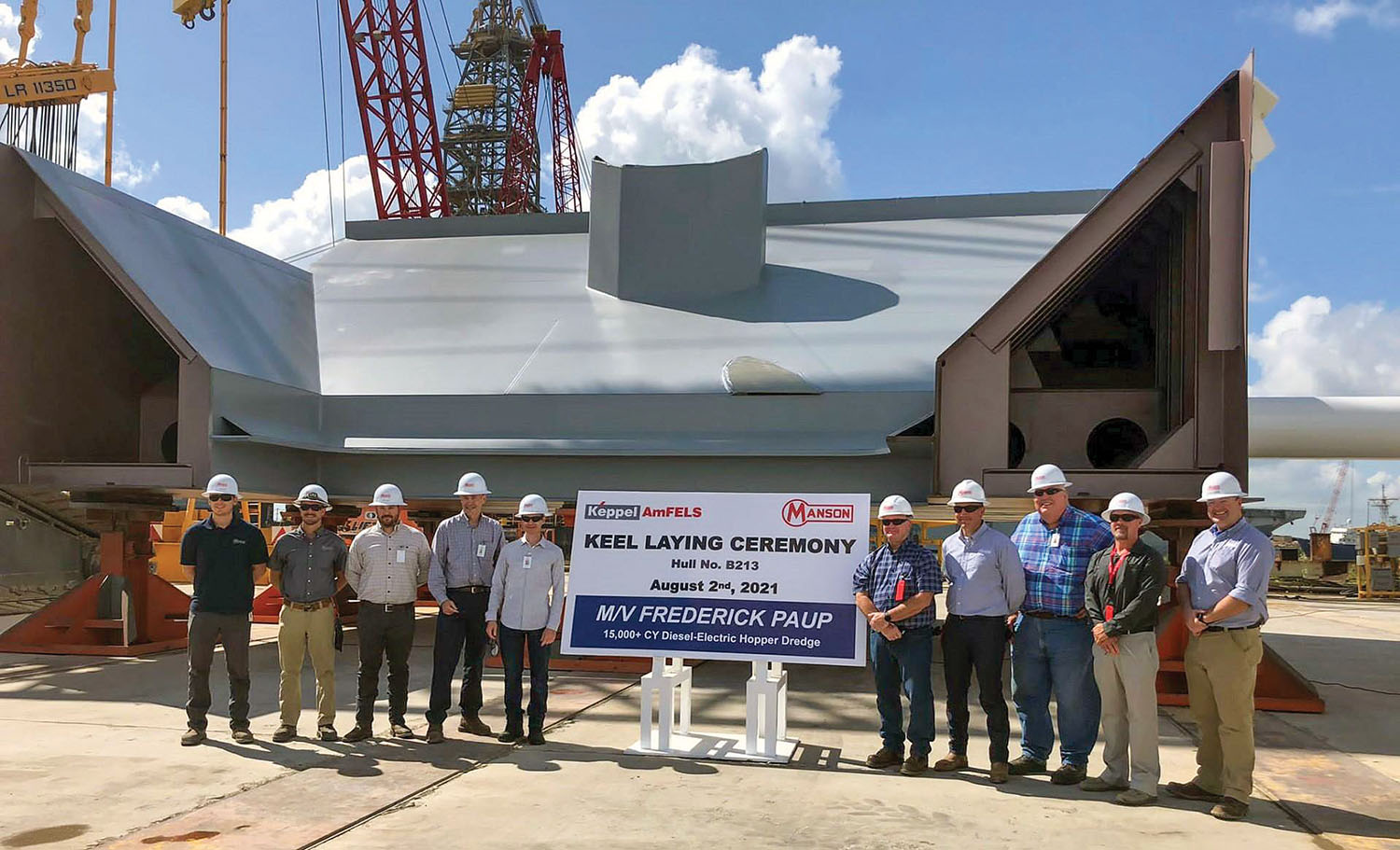 Officials from Manson Construction Company and Keppel AmFELS commemorate the keel-laying for the Frederick Paup.