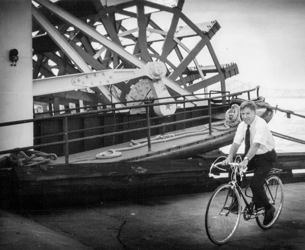 Capt. Doc Hawley travels by bicycle from his French Quarter home to the steamboat Natchez in 1993. (Keith Norrington collection)