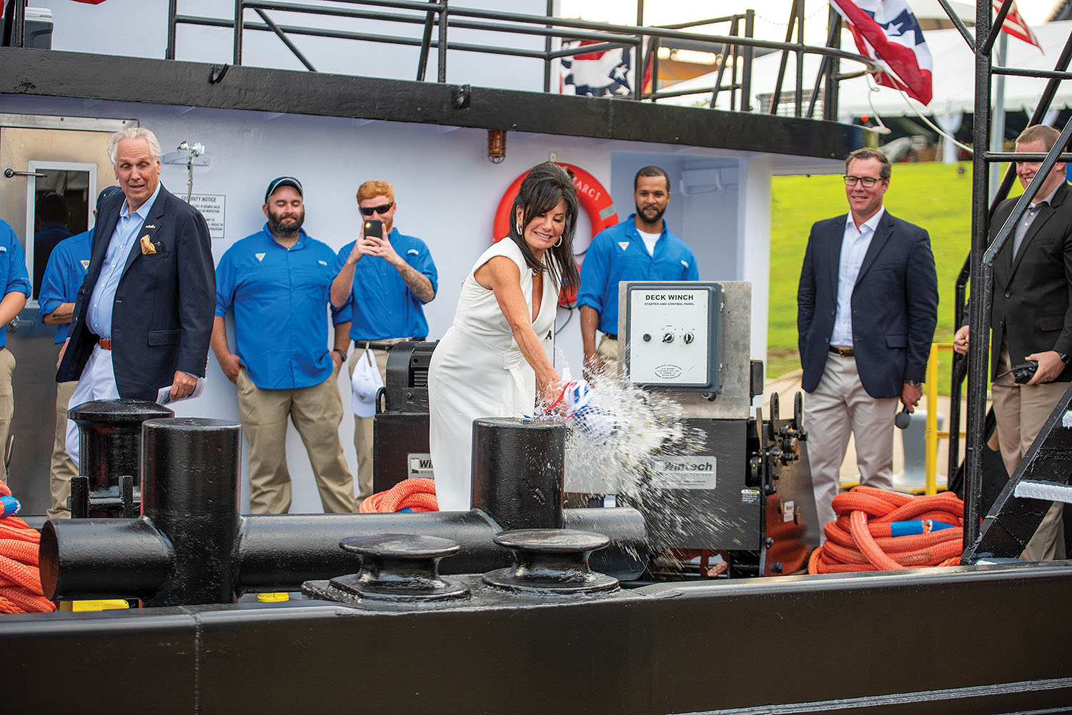 Marci Gale Casselhoff christens her namesake vessel with a bottle of champagne. (Photo by Fisher Fotos)